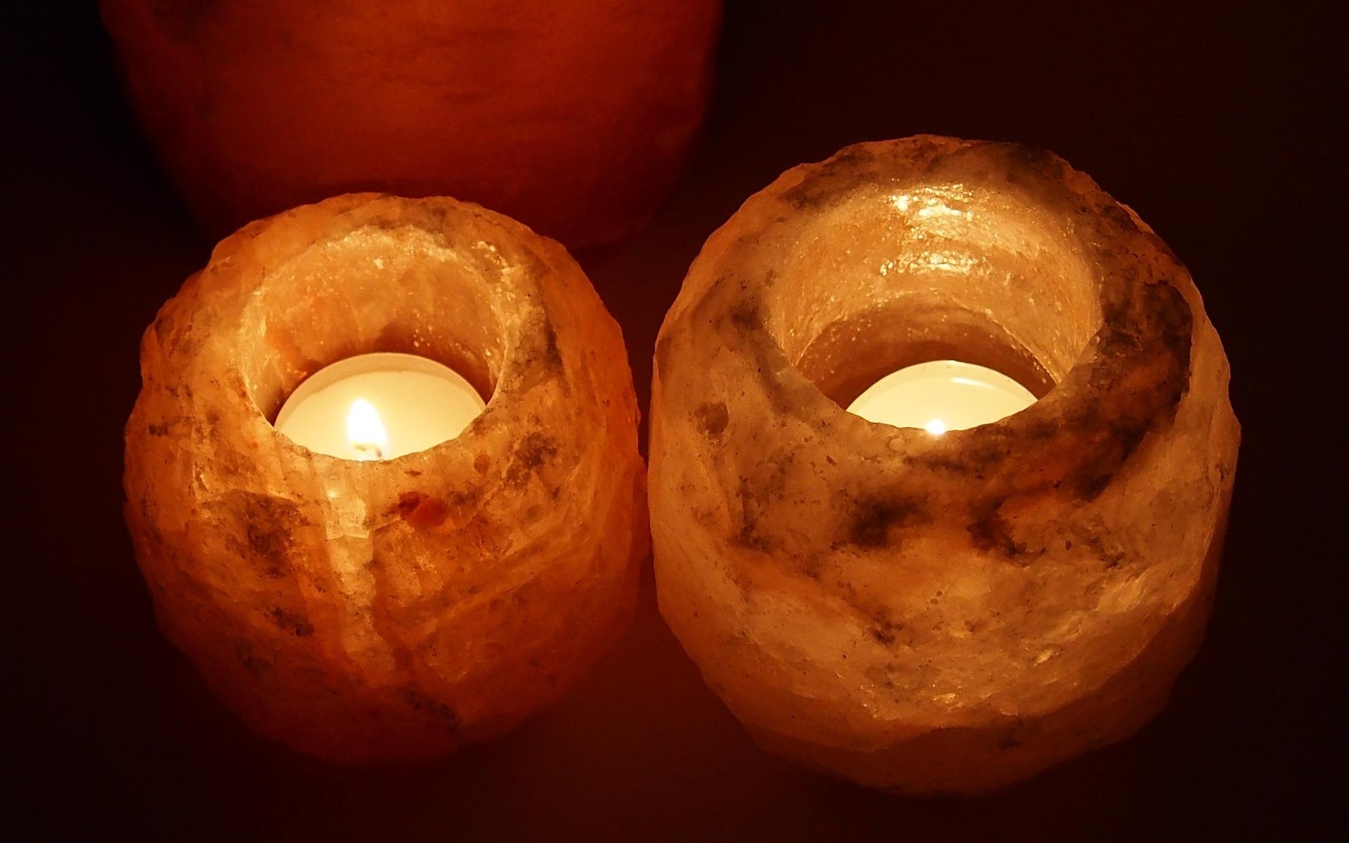 Tealights burning in Himalayan Salt candleholders