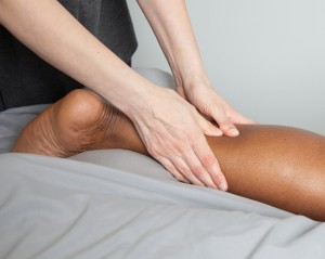 Massage therapist works on a client's lower leg