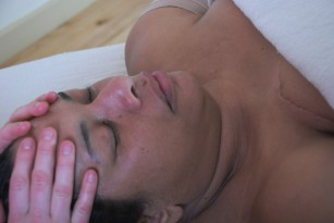 Woman having a relaxing massage to her head and face.