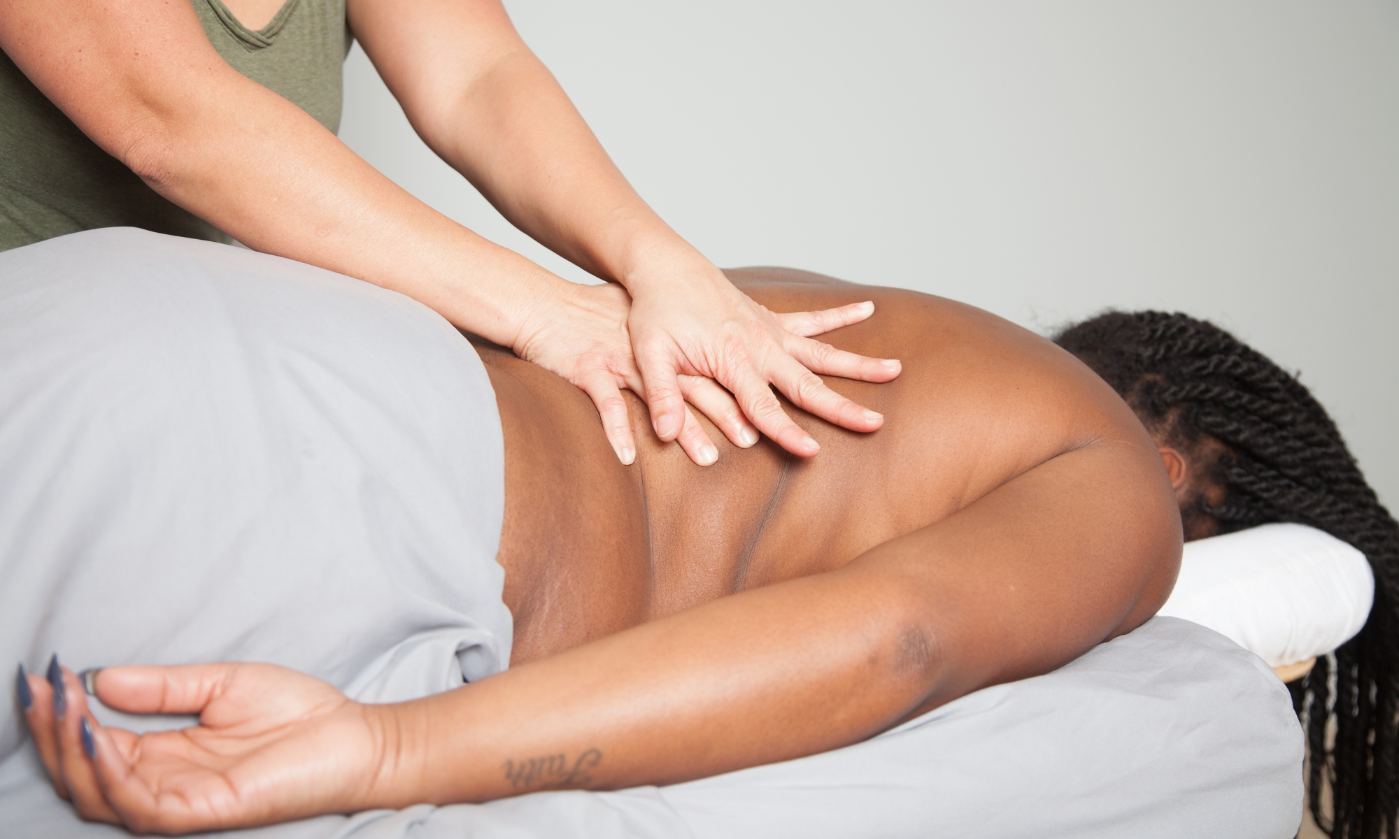 client having massage on their mid-back.