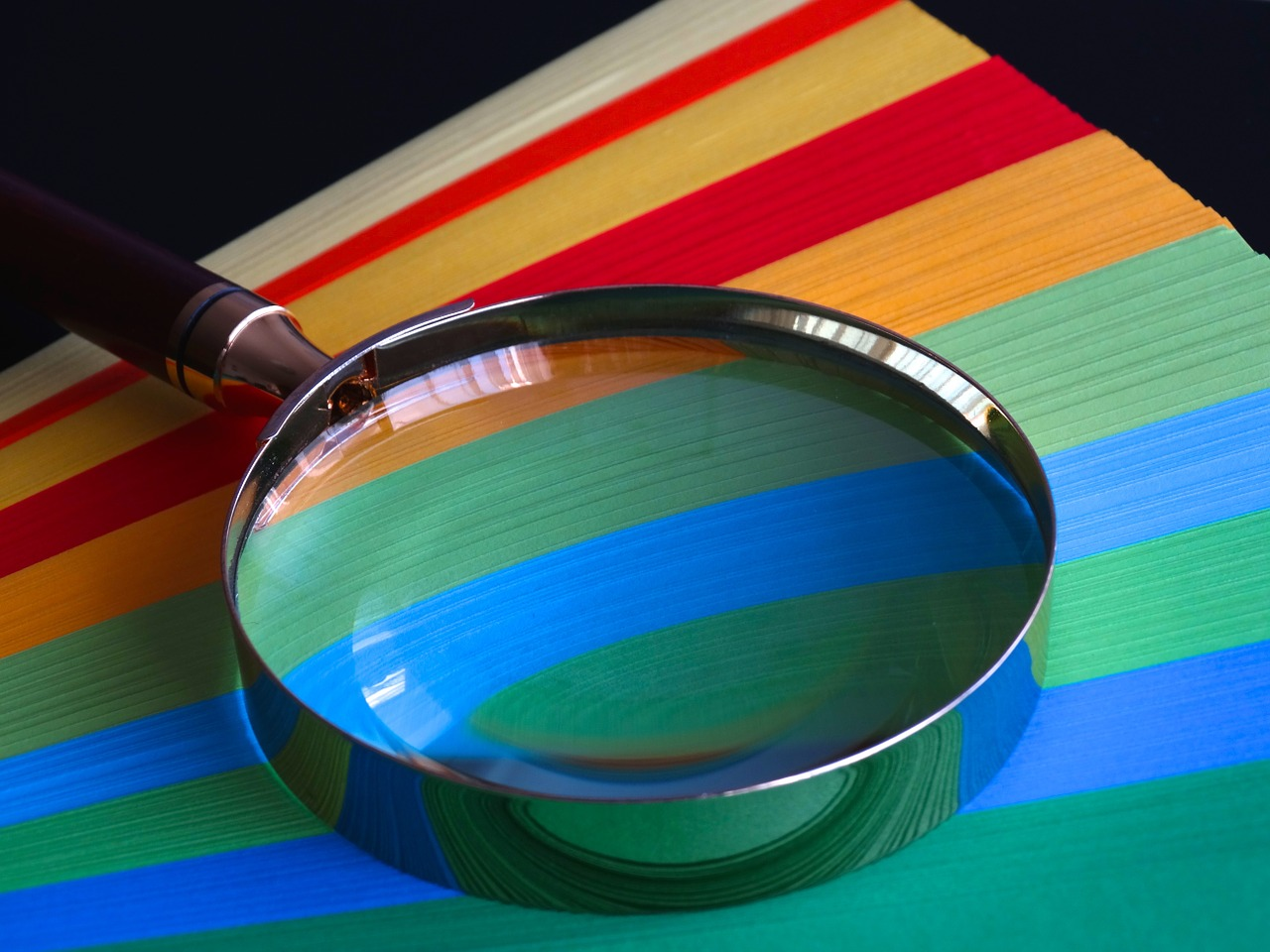 Magnifying glass with colored papers