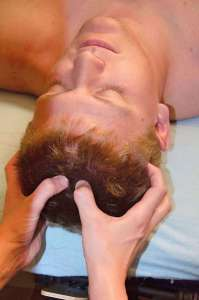Male client having scalp massage