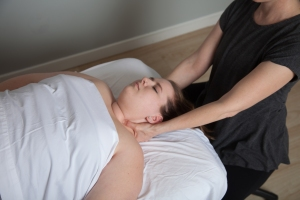 massage therapist working with client's neck