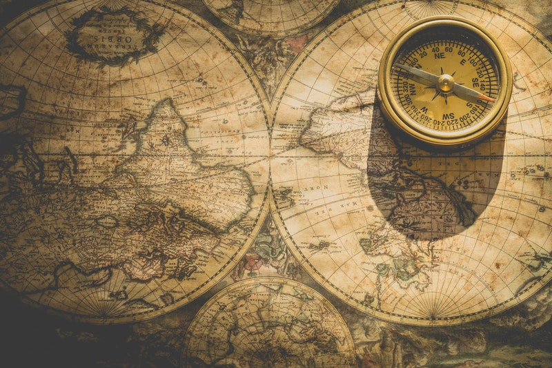 antique world map and compass